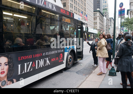 Commuters in New York contend with crowded buses, traffic and long lines on their trip home - Stock Photo