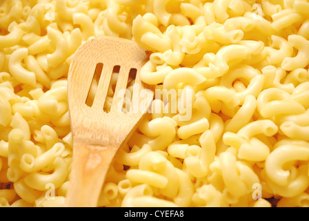A Slotted Wooden Spoon In Cooked Elbow Macaroni Stock Photo