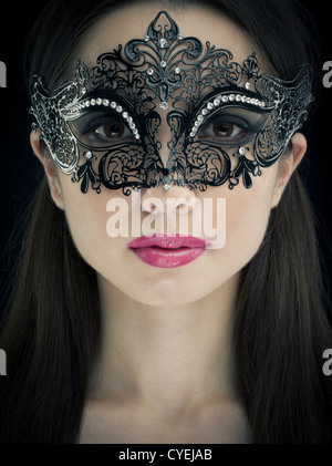 Woman wearing Carnival of Venice Mask - Stock Photo