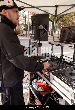 DJ playing music at an outdoor concert - USA - Stock Photo