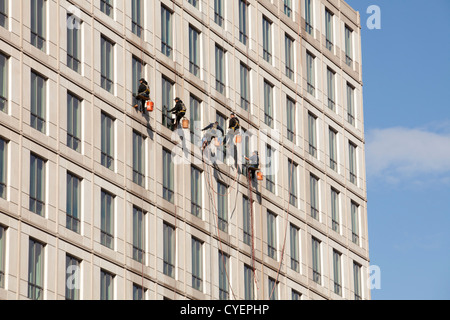 Window cleaners on a highrise building - Stock Photo