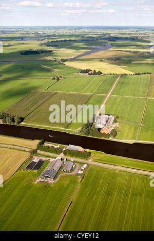 The Netherlands, near Uitwellingerga, Aerial. Farms and farmland. - Stock Photo