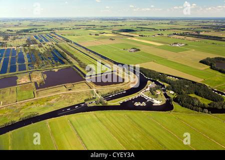 The Netherlands, Nijetrijne, Nature reserve called Rottige Meente and farmland. Small boats in marina. Aerial. - Stock Photo
