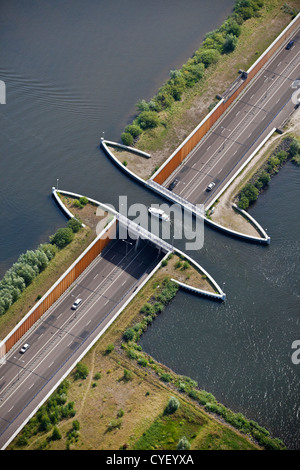 The Netherlands, Harderwijk. Small yacht passing aquaduct. Aerial. - Stock Photo