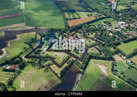 The Netherlands, Vlagtwedde. The fortified, star shaped village of Fort Bourtange. Aerial. - Stock Photo