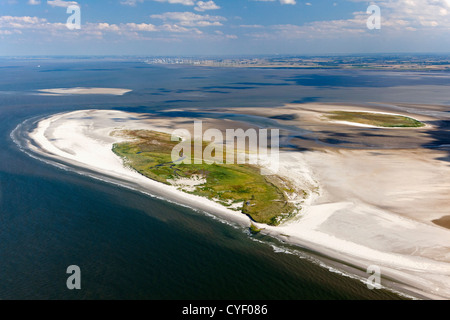Island called Rottumeroog. Part of the Wadden Sea islands. UNESCO World Heritage Site. Marsh land, mud flats. Aerial. - Stock Photo