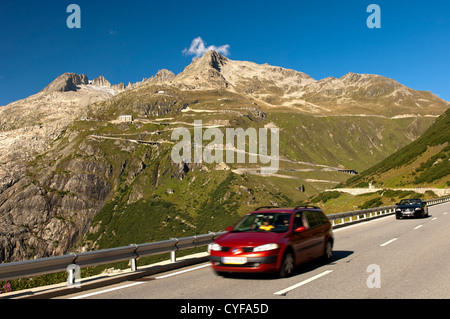 Car on the downhill drive from the Furka pass, Gletsch, Valais, Switzerland - Stock Photo