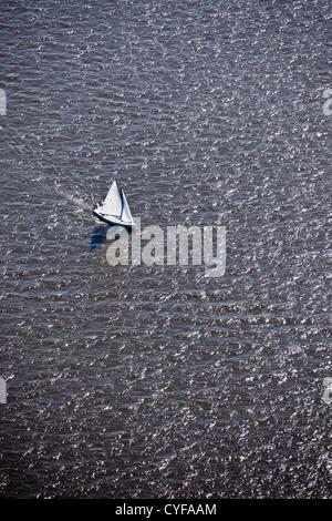 The Netherlands, Loosdrecht, Aerial. Sailing boat on Loosdrecht Lakes. - Stock Photo