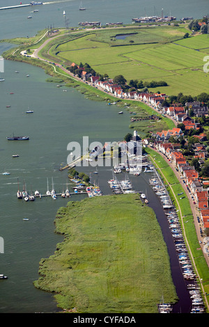 The Netherlands, Durgerdam, Amsterdam, Houses on dyke of lake called IJmeer. Aerial. - Stock Photo