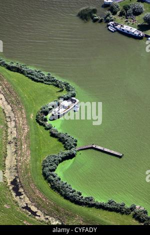 The Netherlands, Akersloot, lake called Alkmaardermeer. Yachts anchored near island. Aerial. - Stock Photo