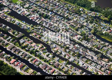 The Netherlands, Loosdrecht, Holiday houses near Loosdrecht Lakes. Aerial. - Stock Photo