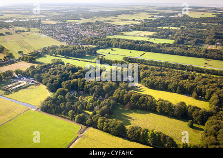 Background view on village called Kortenhoef, foreground: the rural estate called Gooilust. Aerial. - Stock Photo
