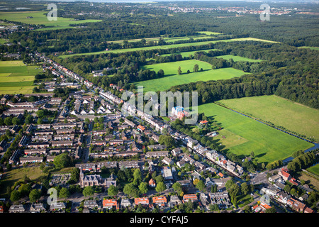 Foreground view on village called Kortenhoef, background the northern part of  the rural estate areas of 'S-Graveland. - Stock Photo