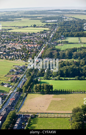 Left: view on village called Kortenhoef, right: the northern part of  the rural estate areas of 'S-Graveland. Aerial. - Stock Photo