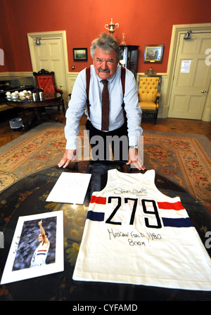 Mayor of Brighton and Hove Cllr Bill Randall with the running vest Steve Ovett wore when he won the Olympic Gold - Stock Photo