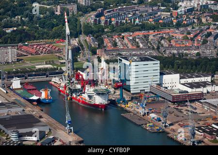 The Netherlands, Rotterdam. Port, harbour near Schiedam. Huge crane on ship. Aerial. - Stock Photo