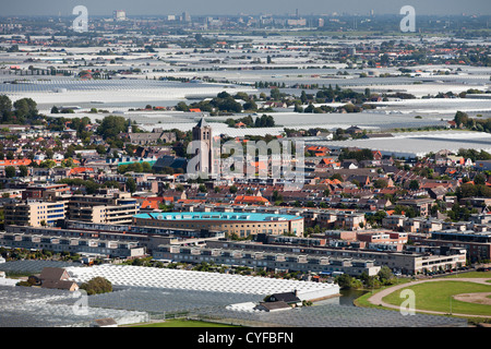The Netherlands, Monster. View on village and glass houses. Aerial. - Stock Photo