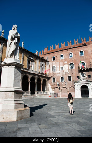 Piazza dei Signori, also known as Piazza Dante in Verona with various palaces around the square and a statue of - Stock Photo