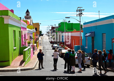 Cape Town, South Africa. Tourists viewing the famous Malay quarter in Bo Kaap near Cape Town South Africa. - Stock Photo