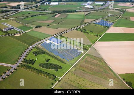 The Netherlands, Heerlen, Industrial solar panel field. Aerial. - Stock Photo