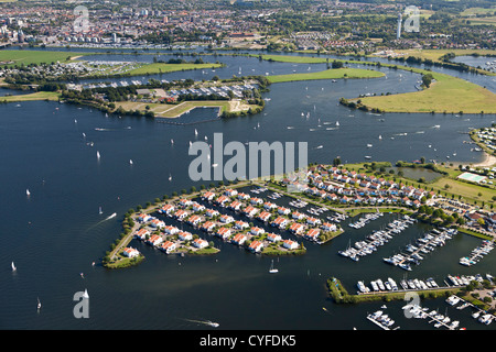 The Netherlands, Herten, Holiday houses and yachts in lakes called Maasplassen. Aerial. - Stock Photo