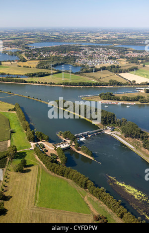 The Netherlands, Maasbracht, Weir in river Maas or Meuse. Aerial. - Stock Photo