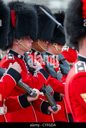 Coldstream guards at changing of the guard at Buckingham palace. London. - Stock Photo