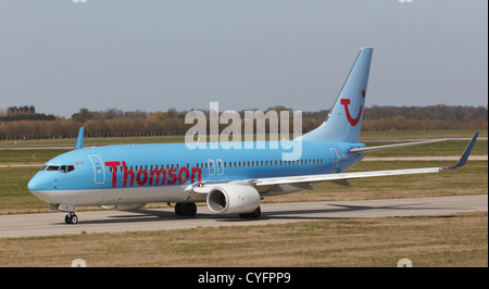 Thomson Boeing 737-800 taxiing to runway to take off - Stock Photo