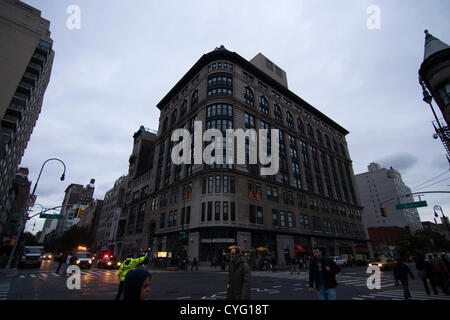 New York USA. November 1st 2012. NYPD Police Officer wearing reflective jacket directs traffic at dusk on 14th Street - Stock Photo