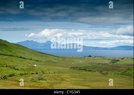 Looking West to the Islands of Eigg and Rhum from Kilmory on the Ardnamurchan Peninsula Scotland.  SCO 8768. - Stock Photo