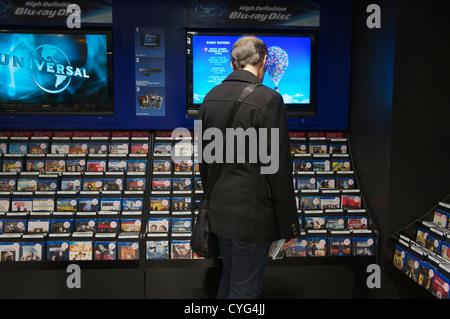 Shopper at HMV retail store Bristol - Stock Photo