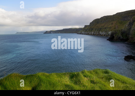 View over ocean from Carrick-a-rede island in Northern Ireland. - Stock Photo