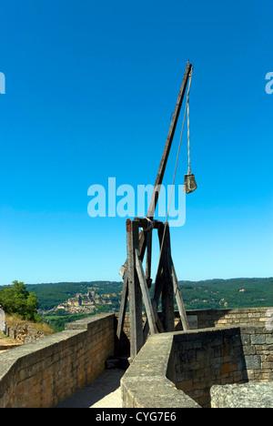 Trebuchet  on the ramparts of Castelnaud Chateau in the Dordogne region of France - Stock Photo