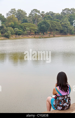 View onto the Moat around the Temple of Angkor Wat, Cambodia - Stock Photo