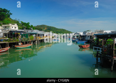 Stilled houses line the shore of Tai O fishing village on Lantau Island Hong Kong China. - Stock Photo