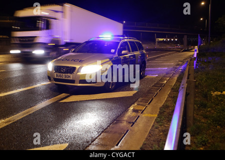 Police patrol car at night - Stock Photo