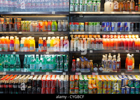 beverages in a fridge shelf - Stock Photo