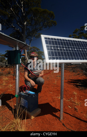 Ecologist with bioacoustic monitoring system, Great Western Woodlands Supersite, Credo Station, Western Australia. - Stock Photo