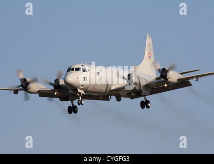 US Navy Lockheed P-3C Orion anti-submarine patrol plane trailing exhaust while on approach - Stock Photo