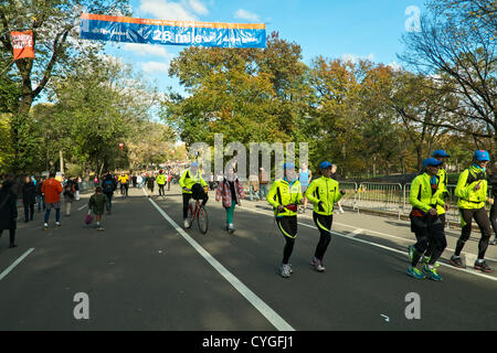 November 4, 2012, New York, NY, US.   Runners cross the 26 mile mark of the route of the New York Marathon, which - Stock Photo