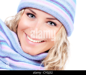 Happy girl in winter hat, beautiful young female wearing knitted warm wintertime clothing, expressing positive emotions - Stock Photo