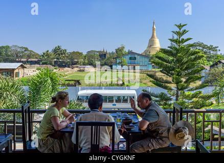 Myanmar, Bago, the Shwemawdaw Paya pagoda seen fron a touristic restaurant. - Stock Photo