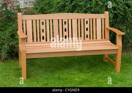 Wooden garden bench - Stock Photo
