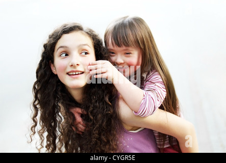 Happy little girl with sister - Stock Photo