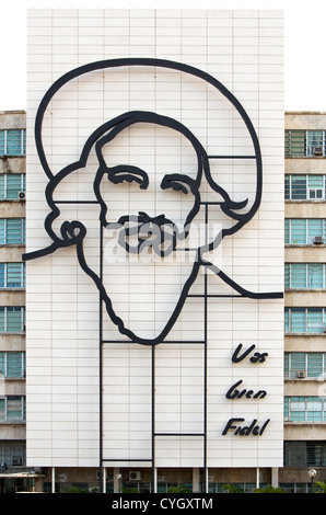 Ministry of Informatics and Communications with image of Camilo Cienfuegos adorning the side of the building. Josi - Stock Photo