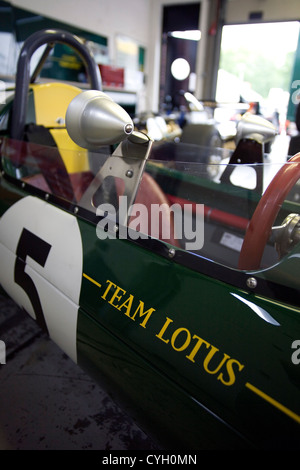 Team Lotus Coventry Climax racing car once driven by Jim Clark in the pits at a racing track. - Stock Photo