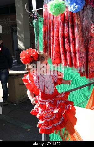 Doll for sale, dressed in traditional Flamenco dress, El Rastro market Madrid, Spain - Stock Photo