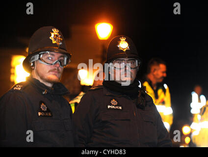 Lewes Sussex UK 5 November 2012 - Police wearing protective goggles at the annual bonfire processions in Lewes Sussex - Stock Photo