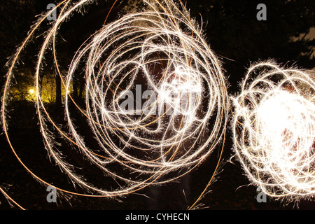 Sparklers on Bonfire night. - Stock Photo