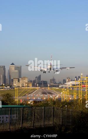 British Airways regional airliner landing at London City Airport, England, UK - Stock Photo